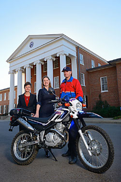 Brandi Hephner LaBanc (left), UM vice chancellor for student affairs, Elizabeth Milhous, director of parent development, and Daniel Ross, UPD officer, get a look at a new motorcycle donated to UPD by the Parents Council. Photo by Robert Jordan