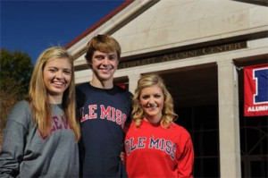 Triplets Haley (left), Suzanne and Beau Harriman of Fort Worth, Texas, share a light moment in front of the University of Mississippi's Triplett Alumni Center.